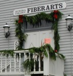 Fresh cedar garland and red bows are a hallmark of Aurora's historic downtown.