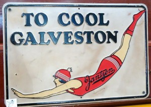 "This vintage metal advertising sign was found in one of our shops.  The ""cool"" bathing beauty is wearing Janzen swimwear, originally made in Oregon."